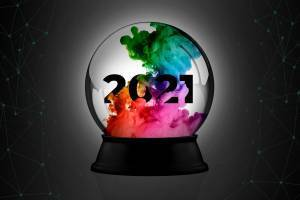 2021 inside of a crystal ball with ink swirling around it.