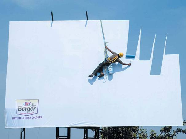 Painter painting a billboard