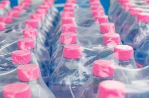case of water bottles in shrink sleeve packaging