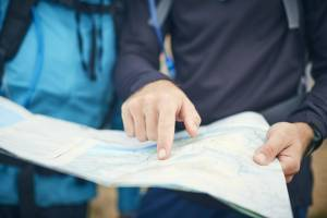 looking at a map printed on waterproof paper out in the field