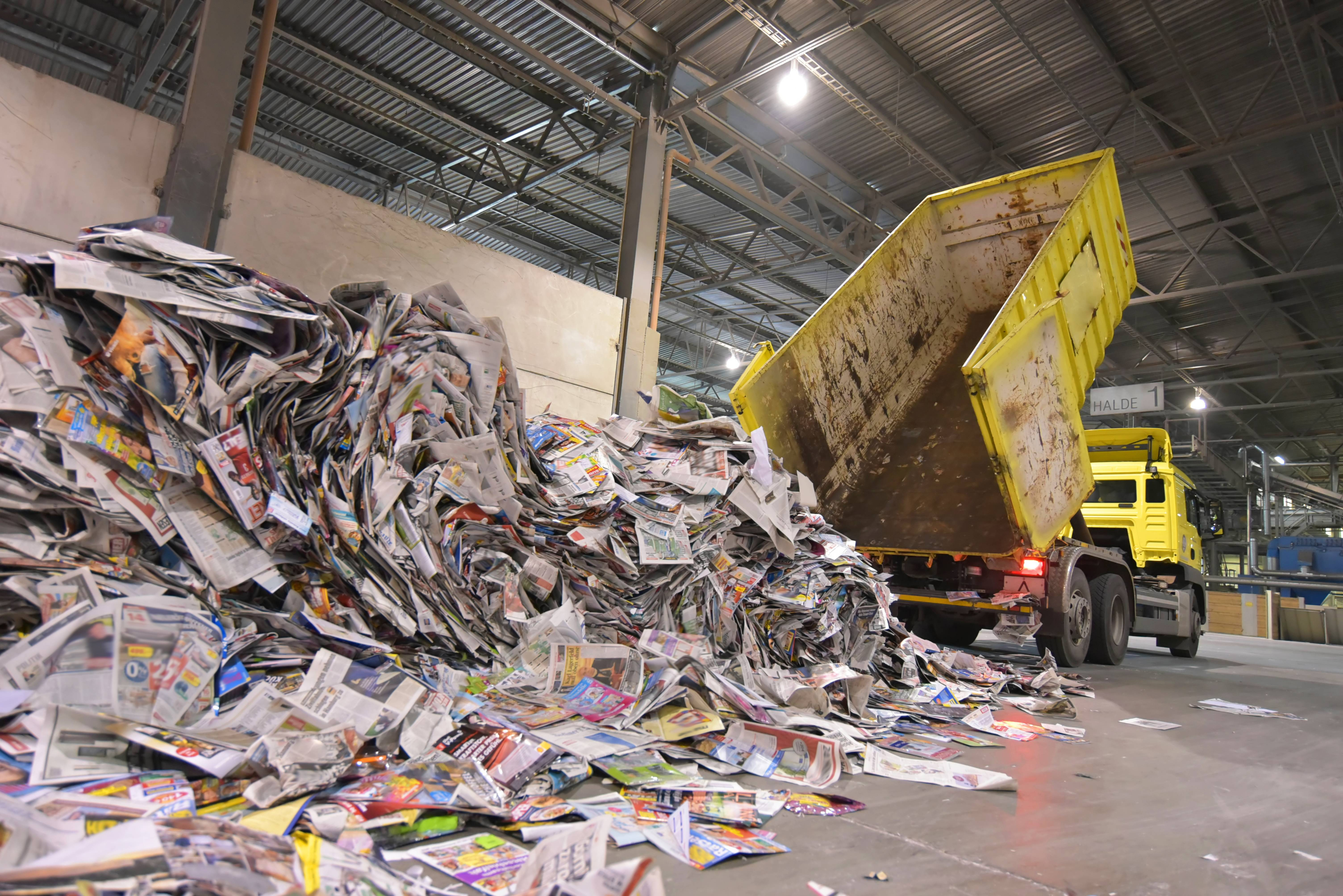 Truck dumps paper for recycling
