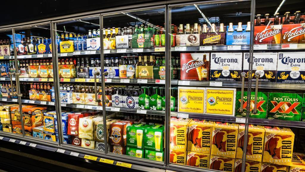 variety of beer brands in store coolers