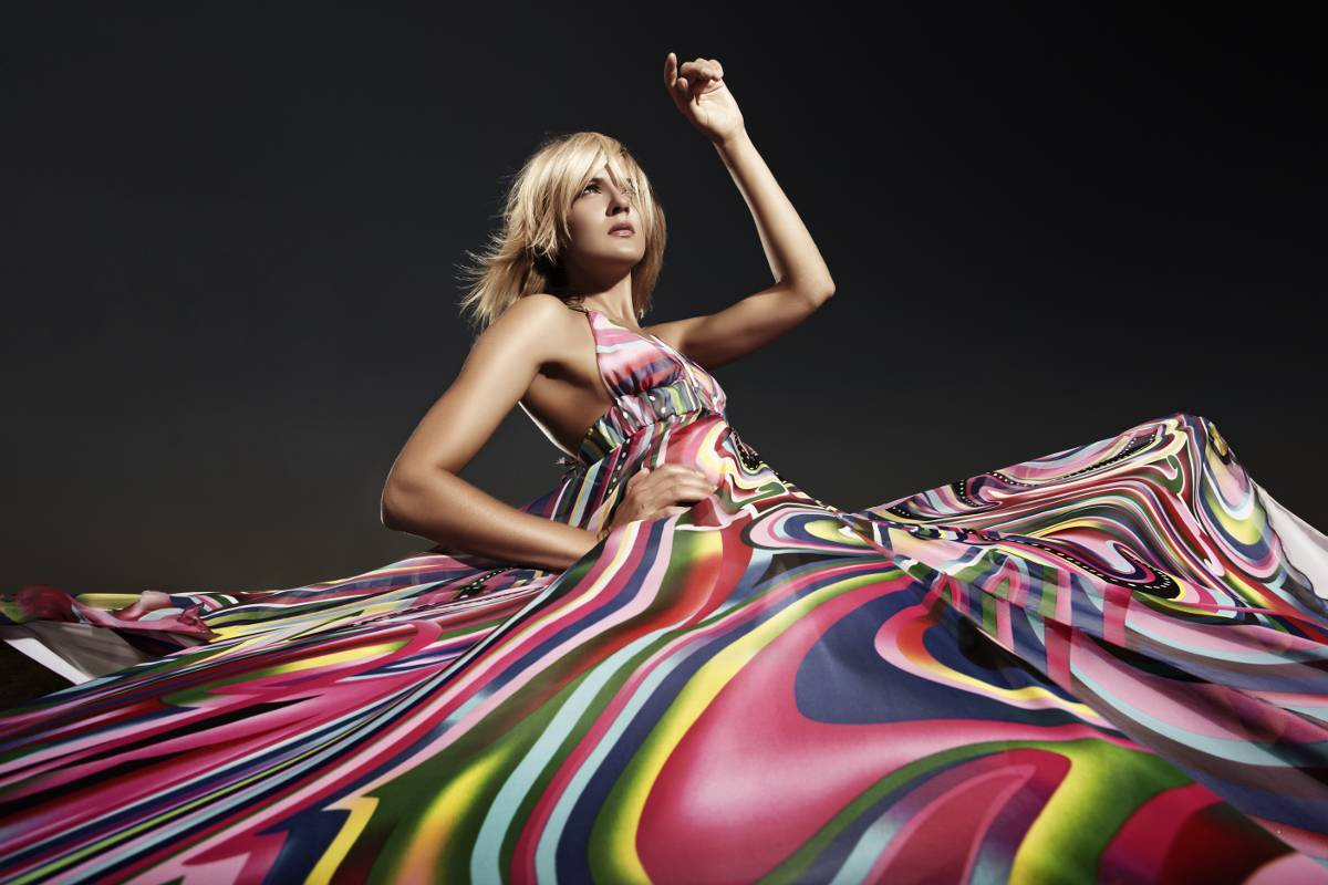 Woman in colorfully printed dress