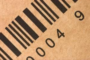 barcode printed in black on brown corrugated cardboard