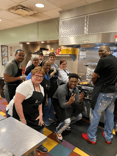 A group of volunteers in a kitchen