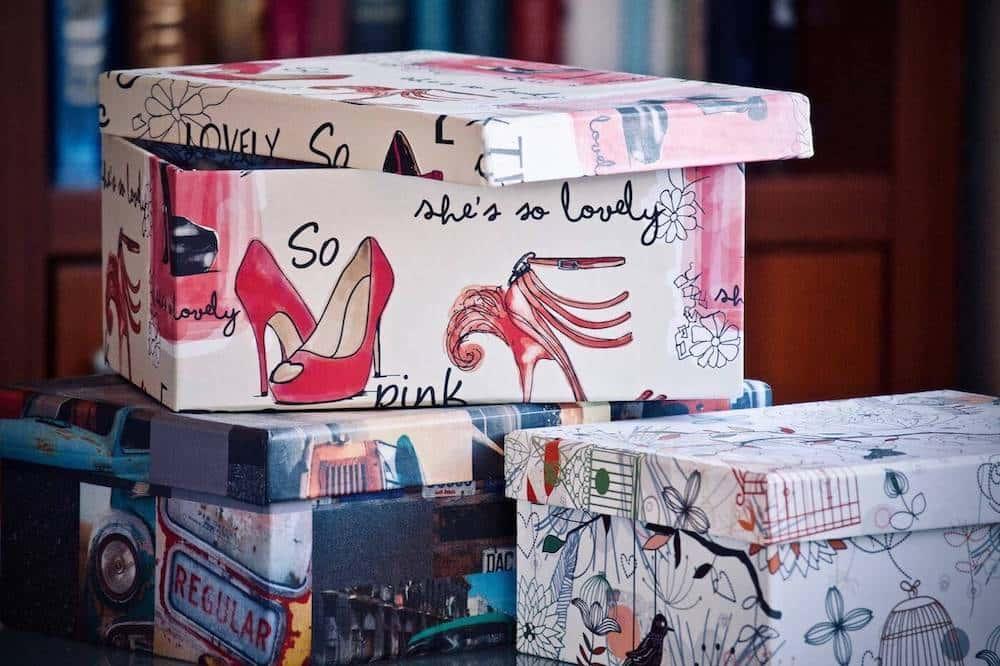 three colorful cardboard storage boxes